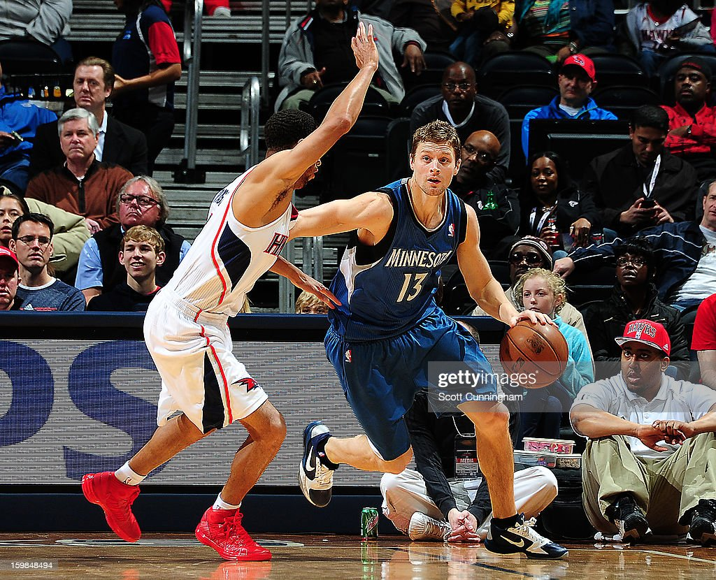 Luke Ridnour #13 of the Minnesota Timberwolves dribbles the ball against the Atlanta Hawks on January 21, 2013 at Philips Arena in Atlanta, Georgia.