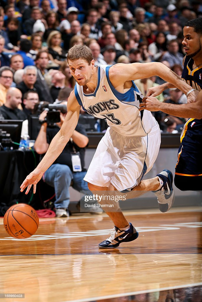 Luke Ridnour #13 of the Minnesota Timberwolves drives against D.J. Augustin #14 of the Indiana Pacers on November 9, 2012 at Target Center in Minneapolis, Minnesota.
