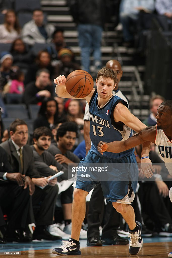 Luke Ridnour #13 of the Minnesota Timberwolves drives against the Charlotte Bobcats at the Time Warner Cable Arena on January 26, 2013 in Charlotte, North Carolina.