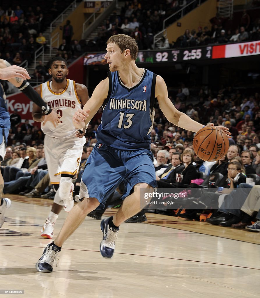 Luke Ridnour #13 of the Minnesota Timberwolves drives against the Cleveland Cavaliers at The Quicken Loans Arena on February 11, 2013 in Cleveland, Ohio.
