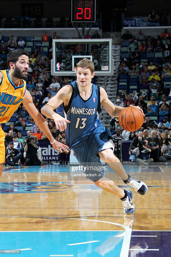 <a gi-track='captionPersonalityLinkClicked' href=/galleries/search?phrase=Luke+Ridnour&family=editorial&specificpeople=201824 ng-click='$event.stopPropagation()'>Luke Ridnour</a> #13 of the Minnesota Timberwolves drives to the basket against the New Orleans Hornets on January 11, 2013 at the New Orleans Arena in New Orleans, Louisiana.