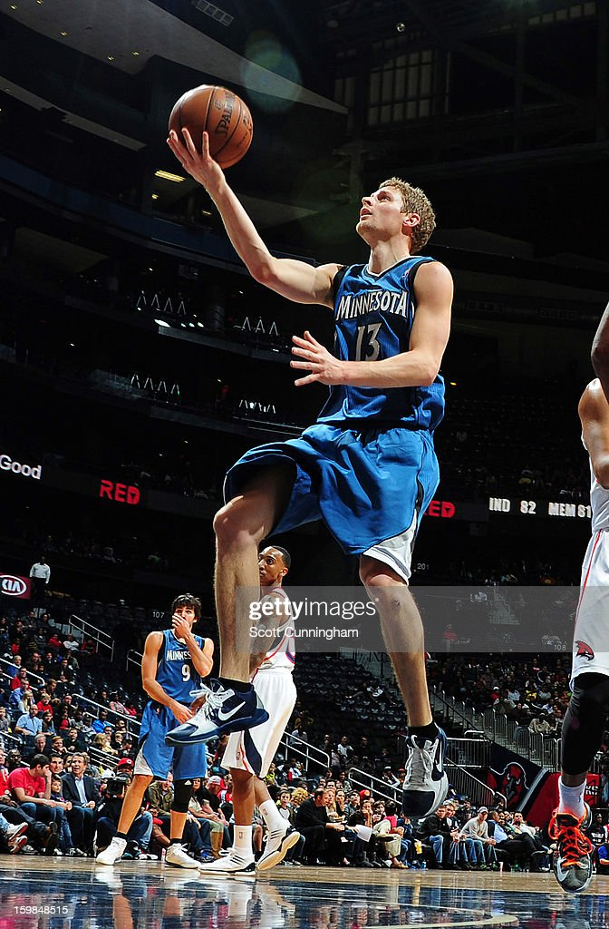 Luke Ridnour #13 of the Minnesota Timberwolves drives to the basket against the Atlanta Hawks on January 21, 2013 at Philips Arena in Atlanta, Georgia.
