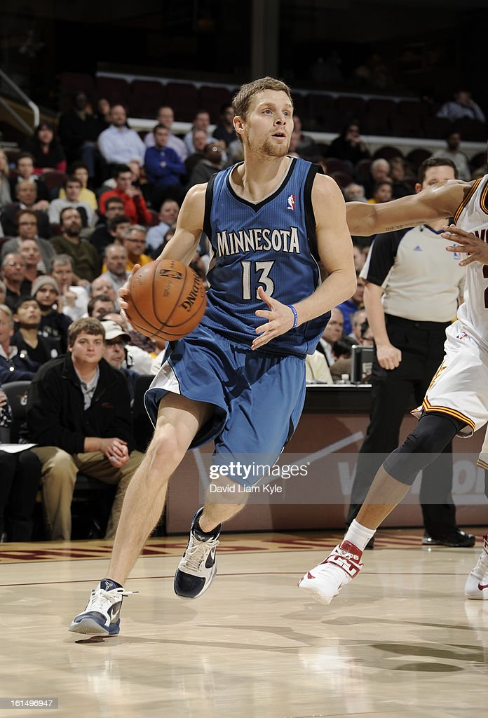 Luke Ridnour #13 of the Minnesota Timberwolves drives to the basket against the Cleveland Cavaliers at The Quicken Loans Arena on February 11, 2013 in Cleveland, Ohio.