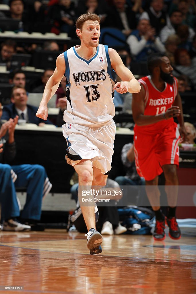 Luke Ridnour #13 of the Minnesota Timberwolves gets excited over the play against the Houston Rockets during the game on January 19, 2013 at Target Center in Minneapolis, Minnesota.