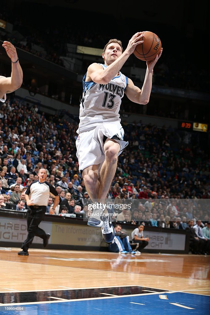 Luke Ridnour #13 of the Minnesota Timberwolves goes to the basket during the game between the Minnesota Timberwolves and the Brooklyn Nets on January 23, 2013 at Target Center in Minneapolis, Minnesota.