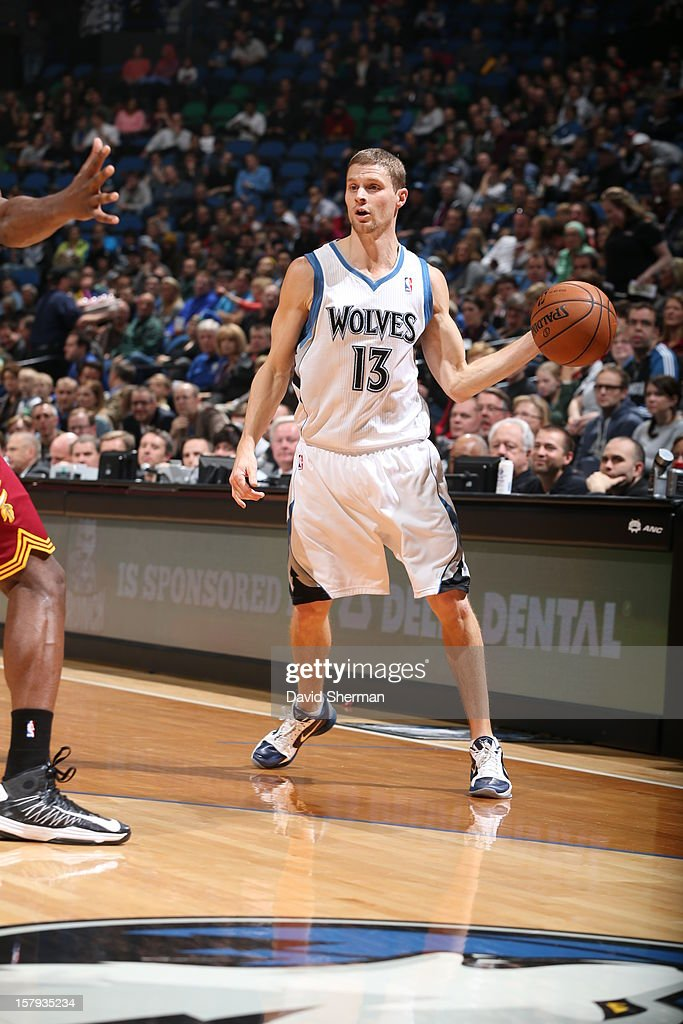 Luke Ridnour #13 of the Minnesota Timberwolves looks to pass the ball against the Cleveland Cavaliers during the game on December 7, 2012 at Target Center in Minneapolis, Minnesota.