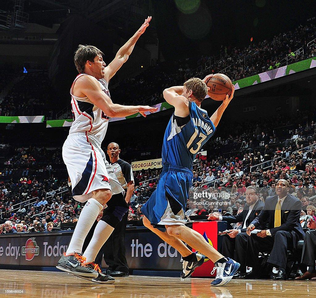 Luke Ridnour #13 of the Minnesota Timberwolves looks to pass the ball against the Atlanta Hawks on January 21, 2013 at Philips Arena in Atlanta, Georgia.