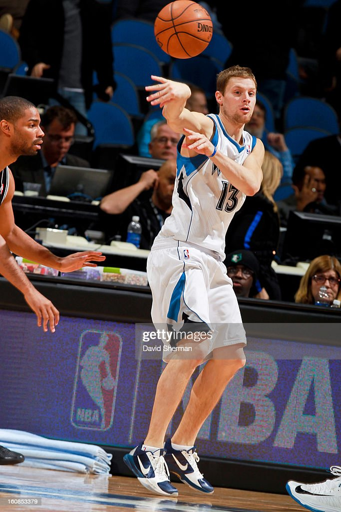 Luke Ridnour #13 of the Minnesota Timberwolves passes the ball against the San Antonio Spurs on February 6, 2013 at Target Center in Minneapolis, Minnesota.
