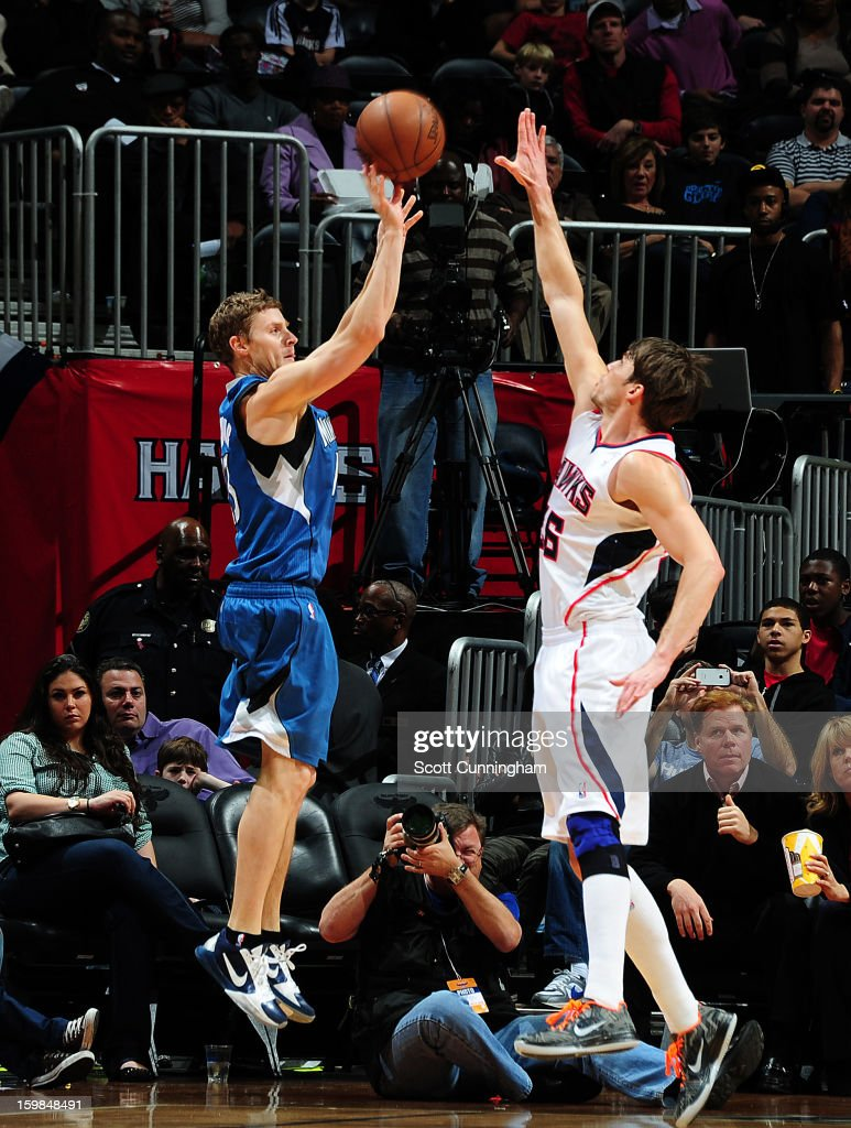Luke Ridnour #13 of the Minnesota Timberwolves takes a shot over Kyle Korver #26 of the Atlanta Hawks on January 21, 2013 at Philips Arena in Atlanta, Georgia.