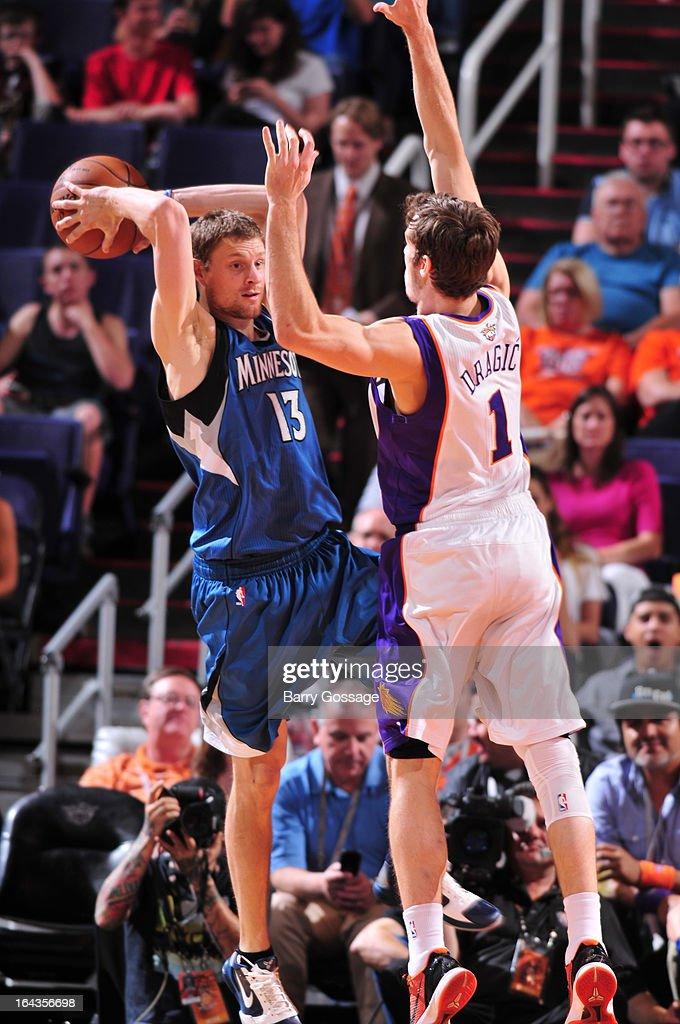 Luke Ridnour #13 of the Minnesota Timberwolves tries to pass around Goran Dragic #1 of the Phoenix Suns on March 22, 2013 at U.S. Airways Center in Phoenix, Arizona.