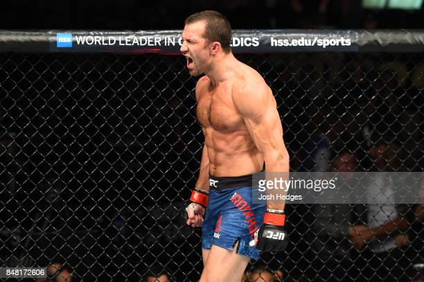 Luke Rockhold celebrates after defeating David Branch in their middleweight bout during the UFC Fight Night event inside the PPG Paints Arena on...