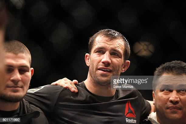 Luke Rockhold poses with members of his team after beating Chris Weidman in their middleweight title fight during UFC 194 at MGM Grand Garden Arena...