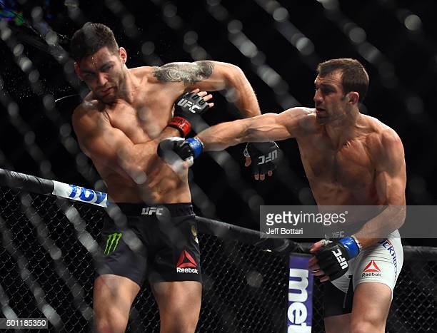 Luke Rockhold punches Chris Weidman in their middleweight championship bout during the UFC 194 event inside MGM Grand Garden Arena on December 12...