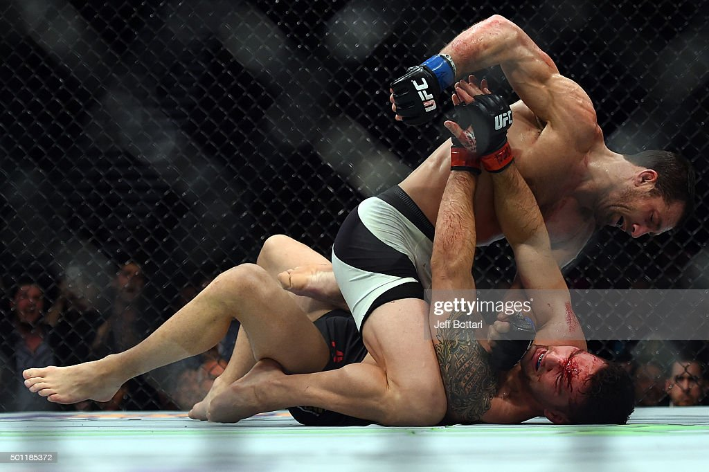 Luke Rockhold punches Chris Weidman in their middleweight championship bout during the UFC 194 event inside MGM Grand Garden Arena on December 12, 2015 in Las Vegas, Nevada.