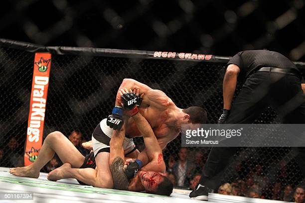 Luke Rockhold punches Chris Weidman in their middleweight title fight during UFC 194 on December 12 2015 in Las Vegas Nevada Rockhold took the title...