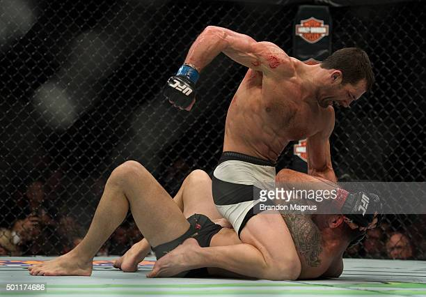 Luke Rockhold punches Chris Weidman in their middleweight title fight during the UFC 194 event inside MGM Grand Garden Arena on December 12 2015 in...