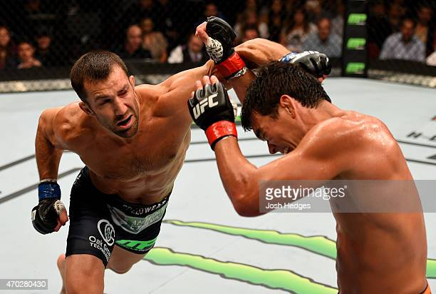 Luke Rockhold punches Lyoto Machida of Brazil in their middleweight bout during the UFC Fight Night event at Prudential Center on April 18 2015 in...