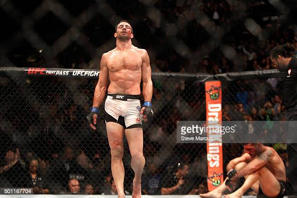 Luke Rockhold walks away from a bloodied Chris Weidman after a fourthround TKO in their middleweight title fight during UFC 194 on December 12 2015...