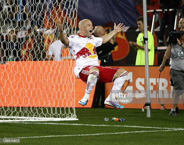 Luke Rodgers of the New York Red Bulls jumps in celebration of his second half penalty kick goal against the Portland Timbers during the game at Red...