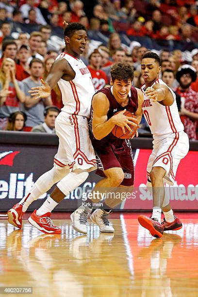 Luke Roh of the Colgate Raiders slips through the defense of Jae'Sean Tate of the Ohio State Buckeyes and D'Angelo Russell of the Ohio State Buckeyes...