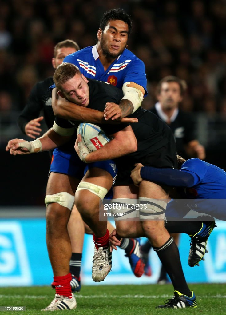 Luke Romano of the All Blacks is tackled by Sebastien Vahaamahina of France during the first test match between the New Zealand All Blacks and France at Eden Park on June 8, 2013 in Auckland, New Zealand.