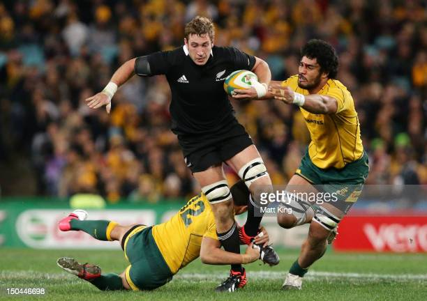 Luke Romano of the All Blacks is tackled during The Rugby Championship Bledisloe Cup match between Australia and New Zealand at ANZ Stadium on August...