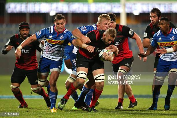 Luke Romano of the Canterbury Crusaders is tackled during the Super Rugby match between New Zealand's Canterbury Crusaders and South Africa's Western...