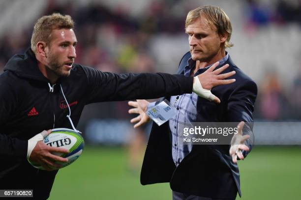 Luke Romano of the Crusaders and Head Coach Scott Robertson of the Crusaders warm up prior to the round five Super Rugby match between the Crusaders...