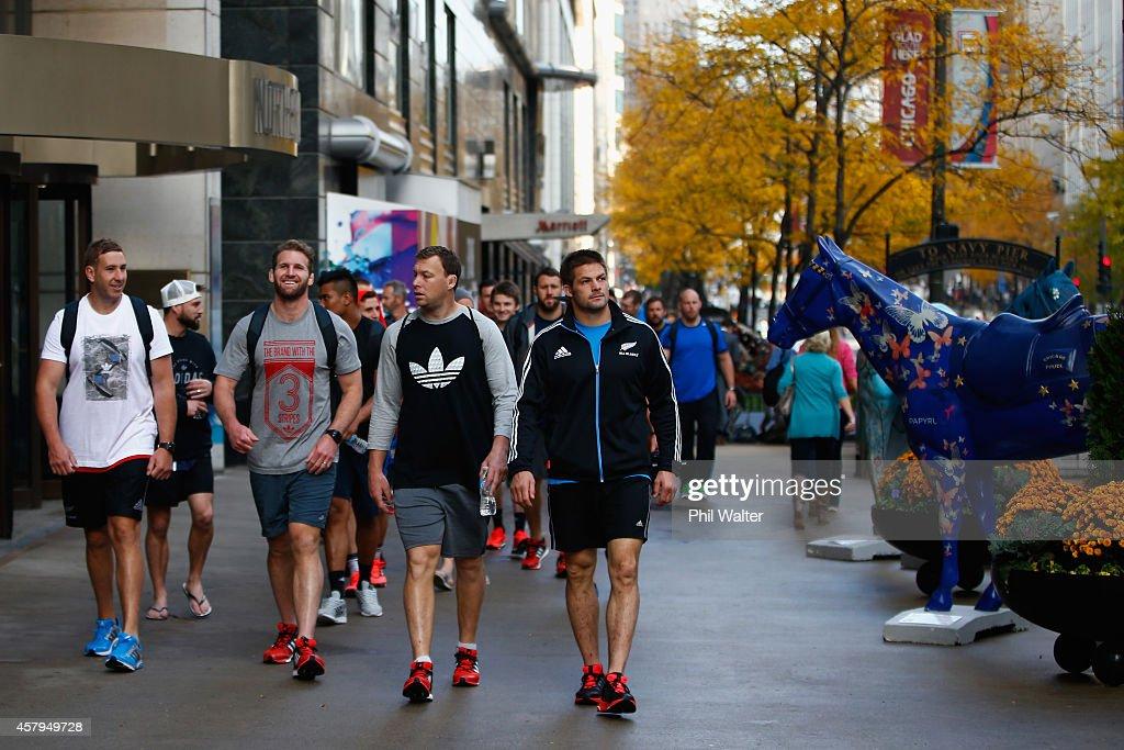 Luke Romanos Kieran Read Wyatt Crockett and Richie McCaw of the New Zealand All Blacks take in a bit of sightseeing as they walk along Michigan Ave...