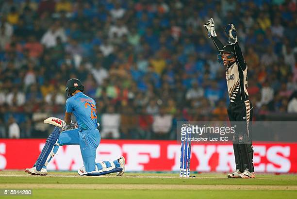 Luke Ronchi of New Zealand appeals and get the LBW of Shikhar Dhawan of India during the ICC World Twenty20 India 2016 Group 2 match between New...