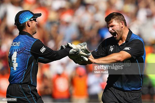 Luke Ronchi of New Zealand congratulates Corey Anderson of New Zealand as he celebrates taking the wicket of Brad Haddin of Australia during the 2015...