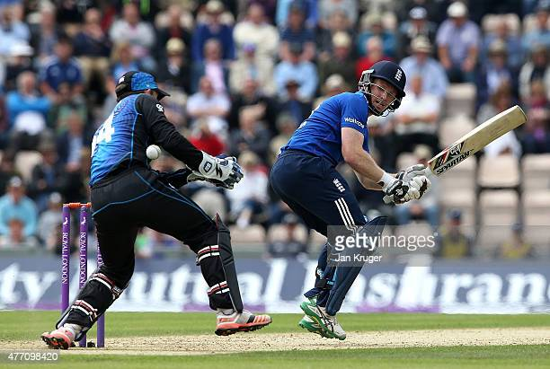 Luke Ronchi of New Zealand fails to gather with Eoin Morgan of England out of his crease during the 3rd ODI Royal London OneDay Series 2015 between...
