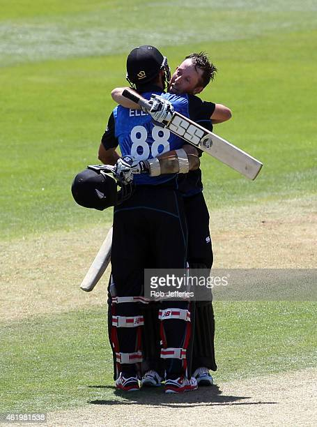 Luke Ronchi of New Zealand is congratulated by Grant Elliott after scoring 100 runs during the One Day International match between New Zealand and...
