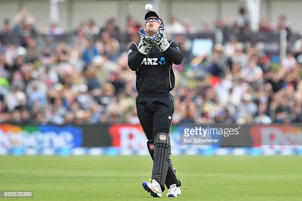 Luke Ronchi of New Zealand takes a catch to dismiss Imrul Kayes of Bangladesh during the first One Day International match between New Zealand and...