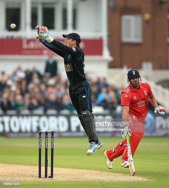 Luke Ronchi of New Zealnd gathers a throw as Ravi Bopara of England tries to make his crease during the 3rd Natwest Series ODI match between England...