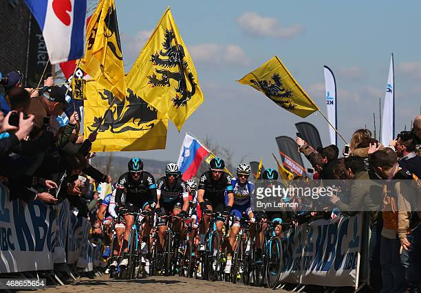 Luke Rowe of Great Britain and Team Sky climbs the Oude Kwaremont with team mates during the 2015 Tour of Flanders from Bruges to Oudenaarde on April...