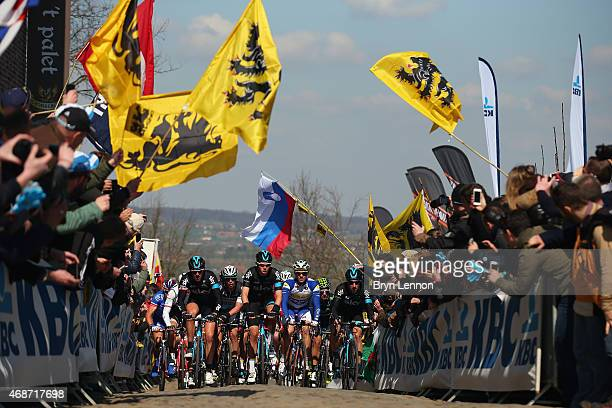 Luke Rowe of Great Britain and Team Sky leads the peloton up the Oude Kwaremont during the 2015 Tour of Flanders from Bruges to Oudenaarde on April 5...