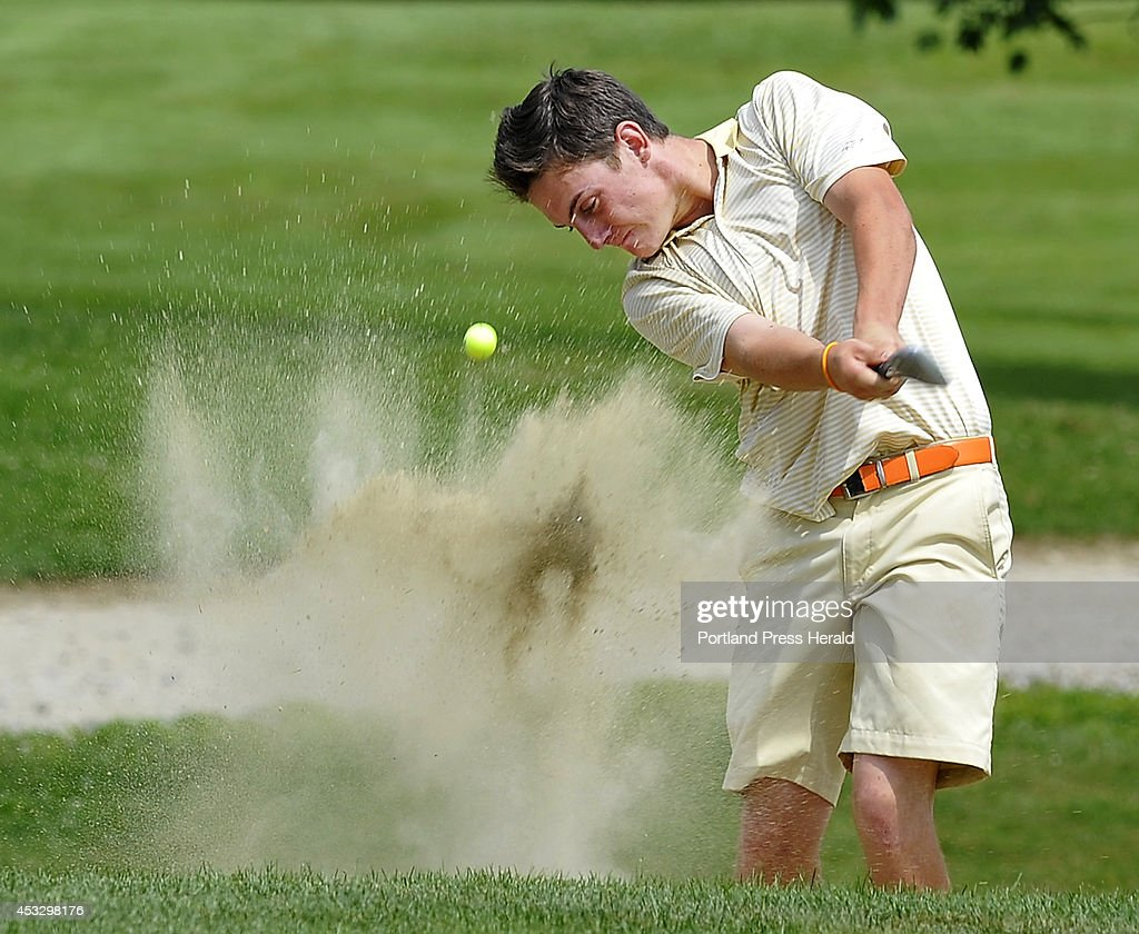 Luke Ruffing, playing in the last group, blasts out of the green side bunker on the eighteenth hole in golf action of Maine Junior Golf Championship, final round, at Val Halla Golf and Recreation in Cumberland Center.