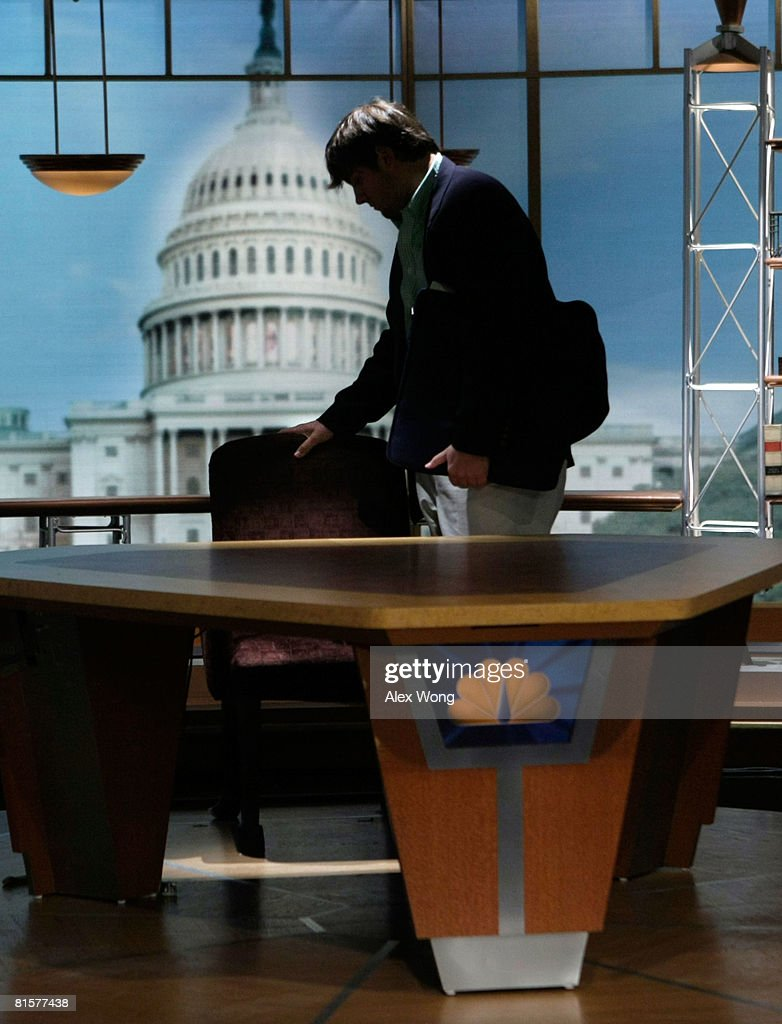 Luke Russert, son of the late moderator of 'Meet the Press' Tim Russert, touches the empty chair that was left behind by his father on the set of the show after a taping June 15, 2008 at the NBC studios in Washington, DC. Tim Russert died June 13, 2008 of a heart attack while at the NBC bureau in Washington at the age of 58.
