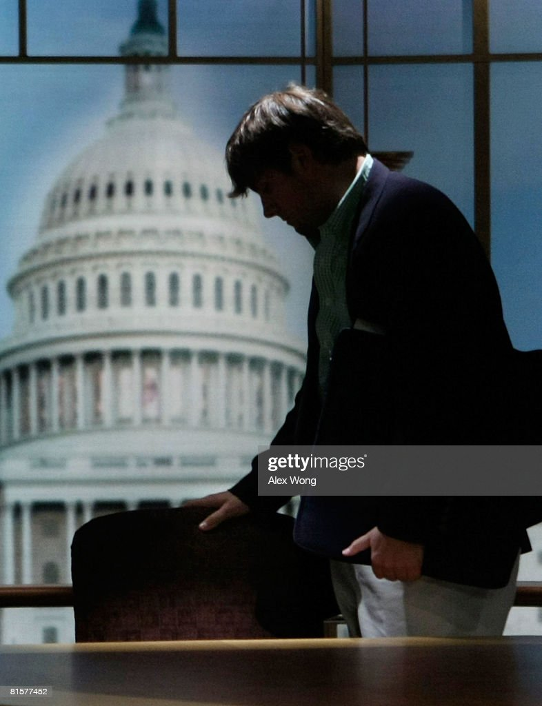 Luke Russert son of the late moderator of 'Meet the Press' Tim Russert touches the empty chair that was left behind by his father on the set of the...