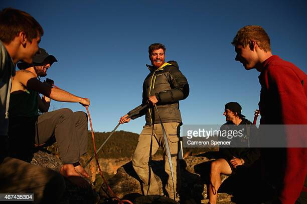Luke Sarantos of Australia talks to friends as he rigs a highline between cliffs at Corroboree Walls in Mount Victoria on March 7 2015 in the Blue...