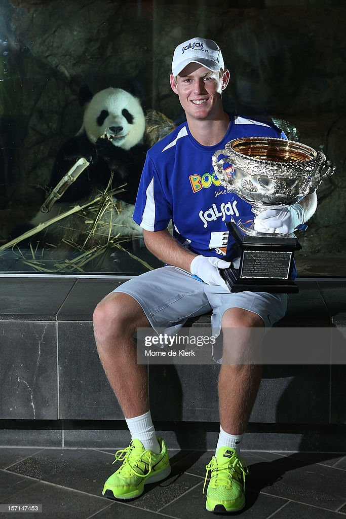 <a gi-track='captionPersonalityLinkClicked' href=/galleries/search?phrase=Luke+Saville&family=editorial&specificpeople=5678639 ng-click='$event.stopPropagation()'>Luke Saville</a> holds the Australian Norman Brookes Challenge Cup in front of the panda enclosure of Funi during the Australian Open Trophy Tour at Adelaide Zoo on November 29, 2012 in Adelaide, Australia.