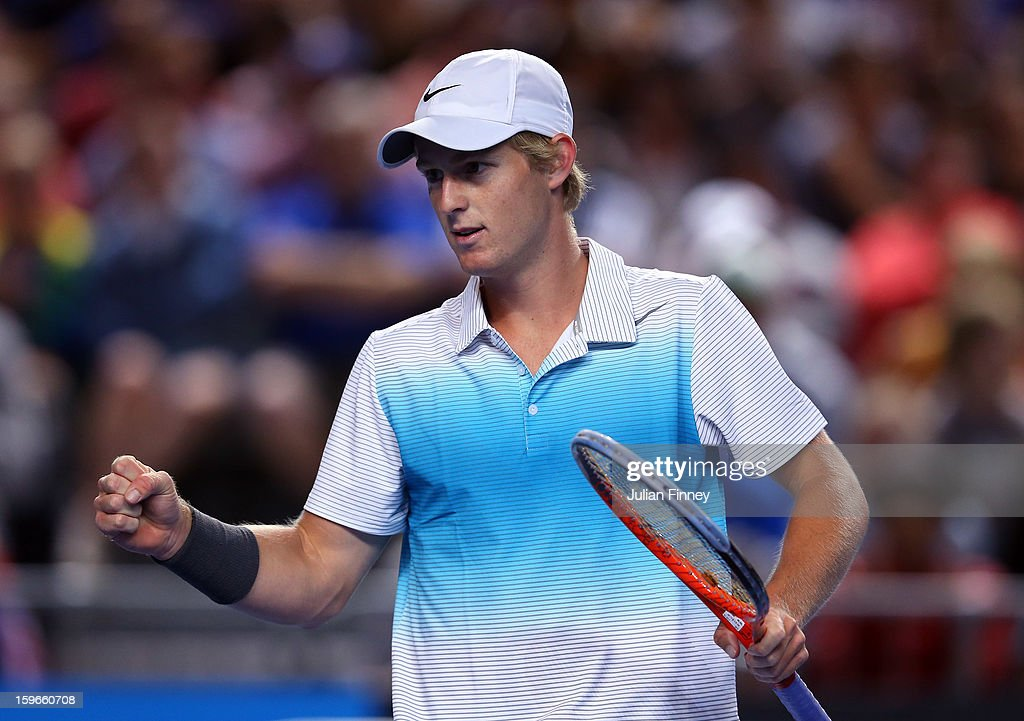Luke Saville of Australia celebrates a point in his mixed doubles match partnered with Samantha Stosur of Australia against Sania Mirza of India and Bob Bryan of USA during day five of the 2013 Australian Open at Melbourne Park on January 18, 2013 in Melbourne, Australia.