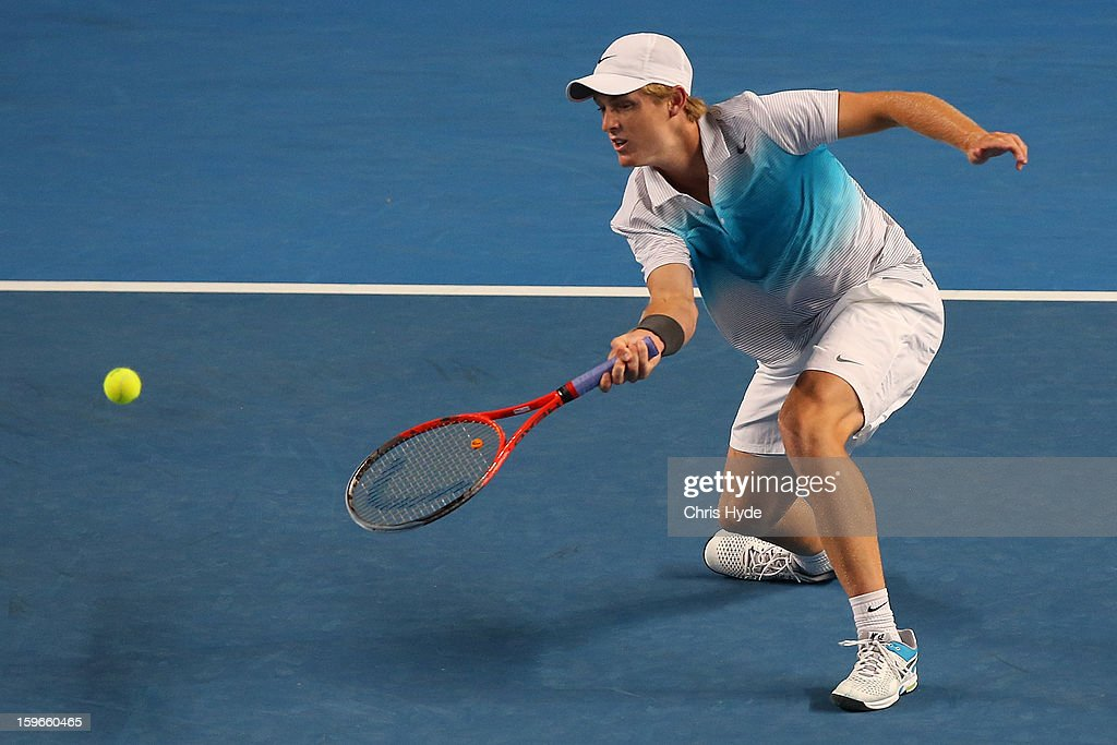 Luke Saville plays a forehand in his mixed doubles match partnered with Samantha Stosur of Australia against Sania Mirza of India and Bob Bryan of USA during day five of the 2013 Australian Open at Melbourne Park on January 18, 2013 in Melbourne, Australia.