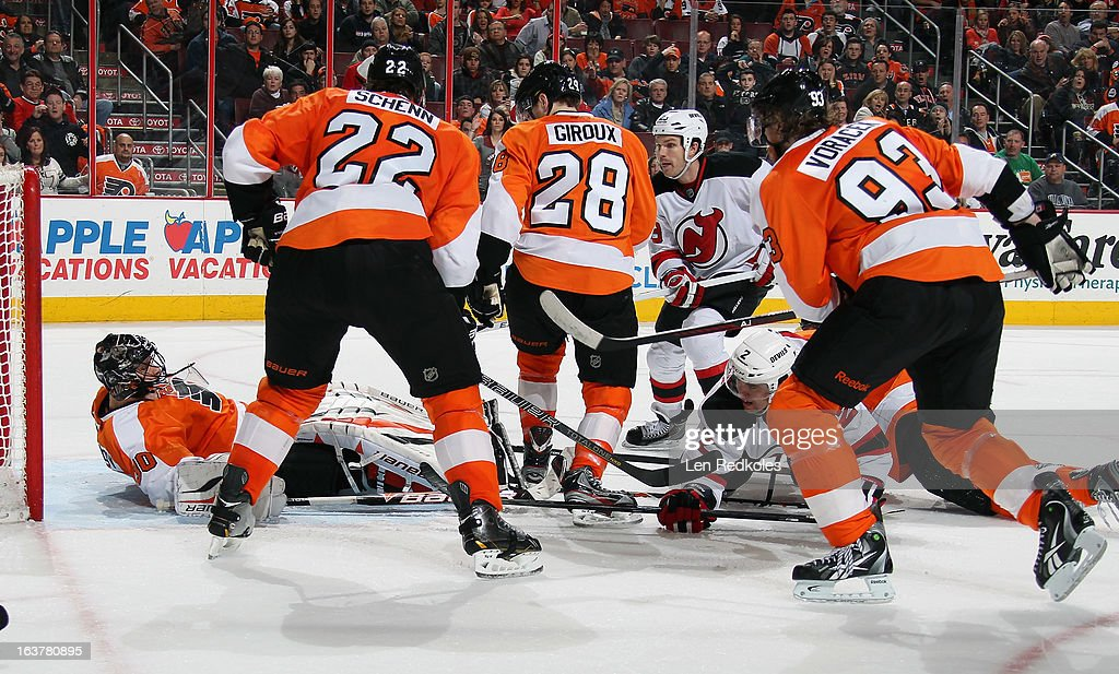 Luke Schenn #22, Claude Giroux #28, Jakub Voracek #93 and goaltender Ilya Bryzgalov #30 of the Philadelphia Flyers defend against David Clarkson #23 of the New Jersey Devils on March 15, 2013 at the Wells Fargo Center in Philadelphia, Pennsylvania. The Flyers went on to defeat the Devils 2-1 in a shoot-out.
