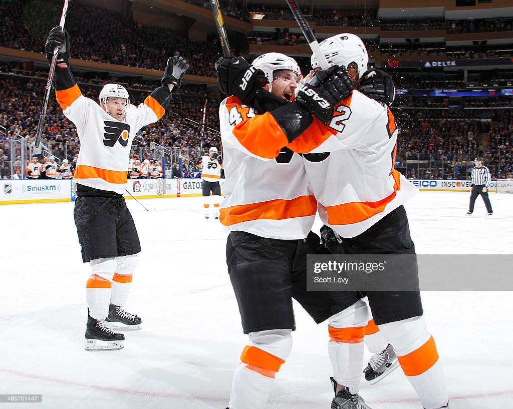 Luke Schenn #22, Michael Raffl #12 and Andrew MacDonald #47 of the Philadelphia Flyers celebrate after a second-period goal against the New York Rangers in Game Two of the First Round of the 2014 Stanley Cup Playoffs at Madison Square Garden on April 20, 2014 in New York City.