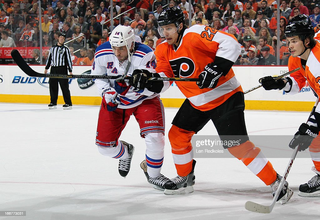 <a gi-track='captionPersonalityLinkClicked' href=/galleries/search?phrase=Luke+Schenn&family=editorial&specificpeople=4254202 ng-click='$event.stopPropagation()'>Luke Schenn</a> #22 of the Philadelphia Flyers battles for position after a face-off with <a gi-track='captionPersonalityLinkClicked' href=/galleries/search?phrase=Taylor+Pyatt&family=editorial&specificpeople=204508 ng-click='$event.stopPropagation()'>Taylor Pyatt</a> #14 of the New York Rangers on April 16, 2013 at the Wells Fargo Center in Philadelphia, Pennsylvania.