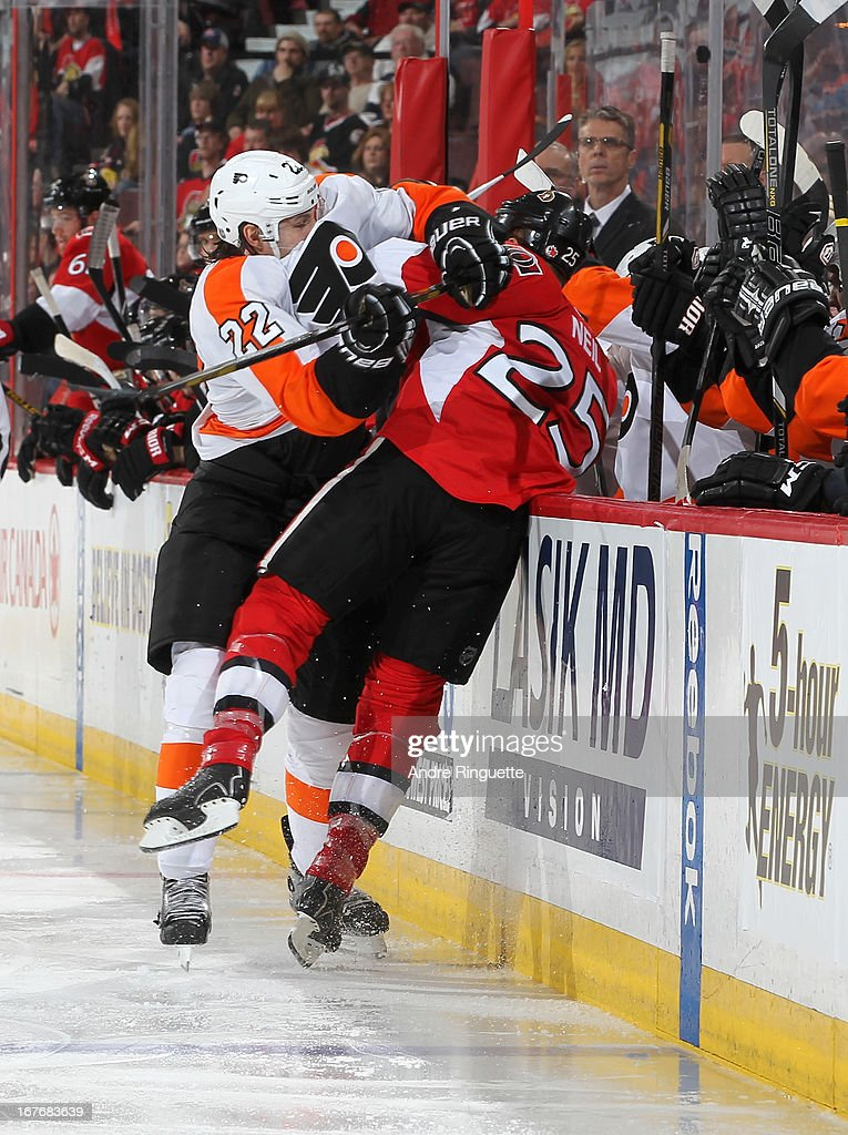 <a gi-track='captionPersonalityLinkClicked' href=/galleries/search?phrase=Luke+Schenn&family=editorial&specificpeople=4254202 ng-click='$event.stopPropagation()'>Luke Schenn</a> #22 of the Philadelphia Flyers body checks Chris Neil #25 of the Ottawa Senators against the boards at the players' bench on April 27, 2013 at Scotiabank Place in Ottawa, Ontario, Canada.