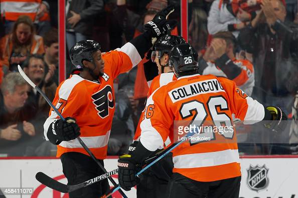 Luke Schenn of the Philadelphia Flyers celebrates his second period goal against the Edmonton Oilers with teammates Wayne Simmonds and Carlo...