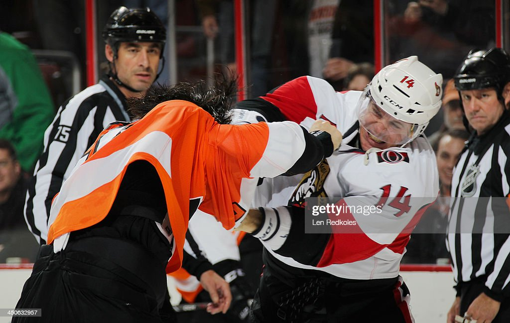 Luke Schenn #22 of the Philadelphia Flyers fights Colin Greening #14 of the Ottawa Senators in the second period on November 19, 2013 at the Wells Fargo Center in Philadelphia, Pennsylvania.